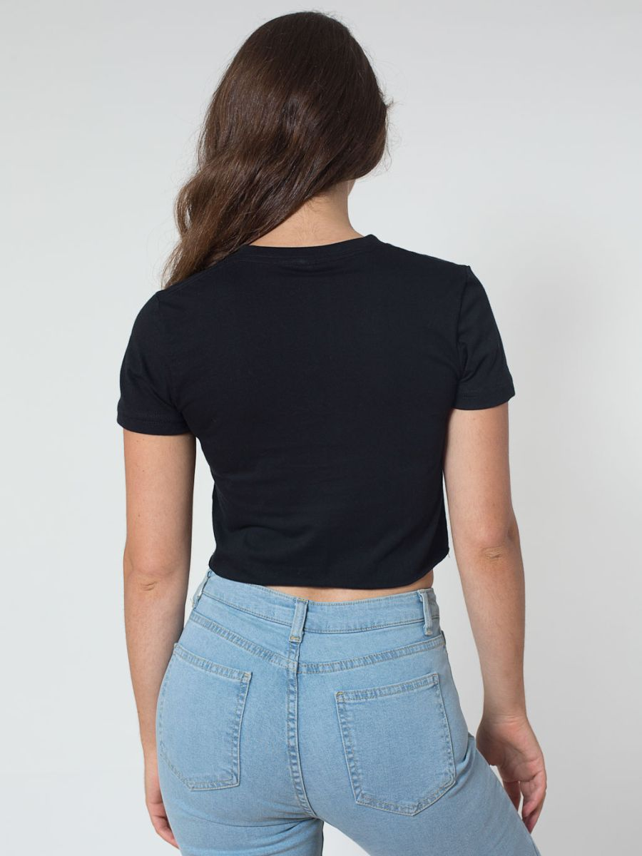 cadce93be96 This soft and smooth cropped tee shirt by American Apparel is made off 100%  cotton 4.3oz fine jersey. The bottom hem is an unfinished raw edge.