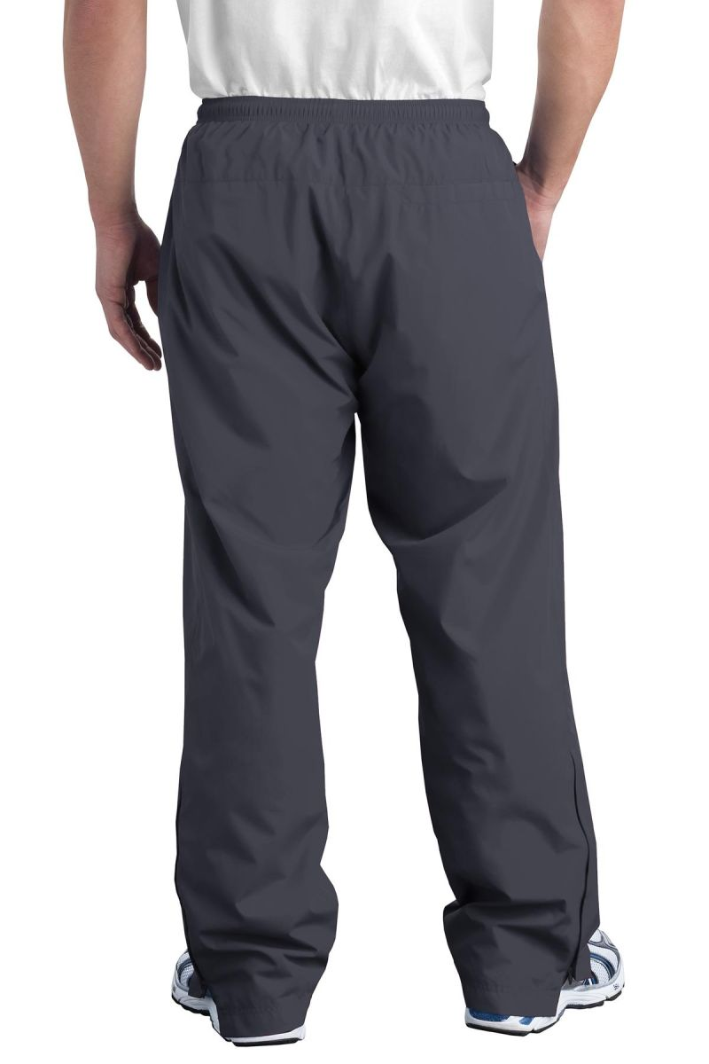 Sport Tek Pst74 Blankstyle Com This sport tek pst74 wind pant is made of 100% polyester and has mesh lining above the knees and poly lining below the knees for easy on and off. sport tek wind pant pst74